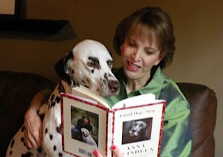 Lynda and Reggie reading Anna Quindlen's book Good Dog