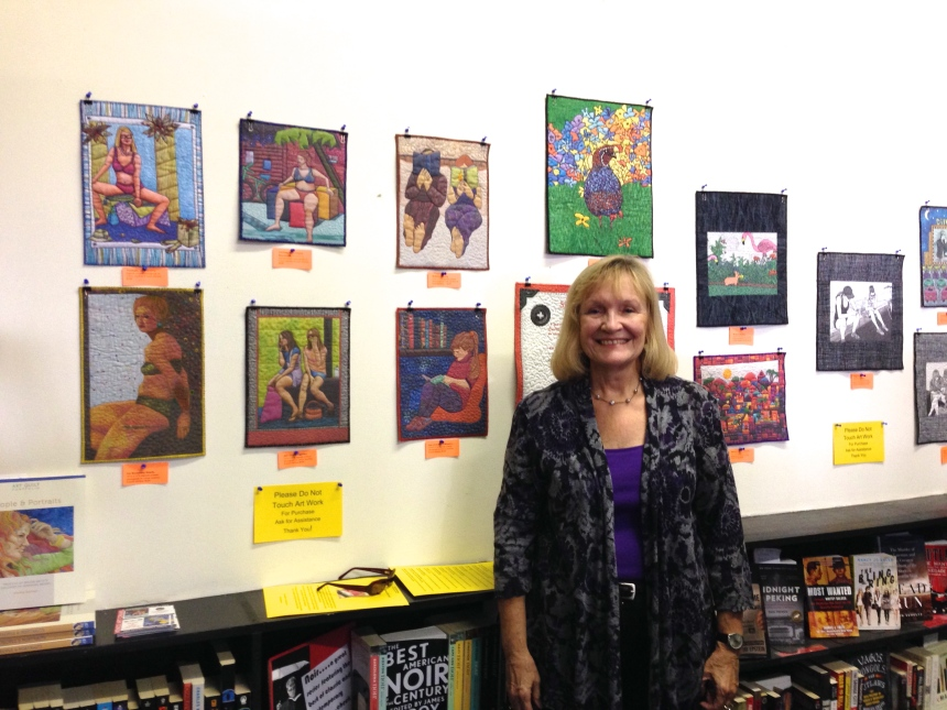 Sherry with her mini-art quilt reproductions at Small World Bookstore/Venice Art Crawl on September 19, 2013.