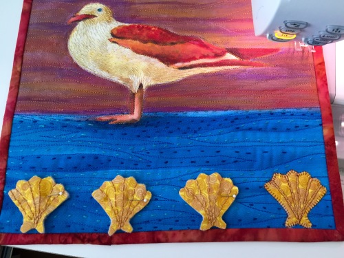 Scallop shells added to bottom border.  Individually batted and hand stitched.